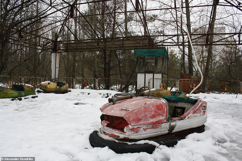 The exclusion zone, which covers a substantial area in Ukraine and some of bordering Belarus, will remain in effect for generations to come, until radiation levels fall to safe enough levels. Pictured: Another part of the amusement park in the ghost town of Pripyat that never got used