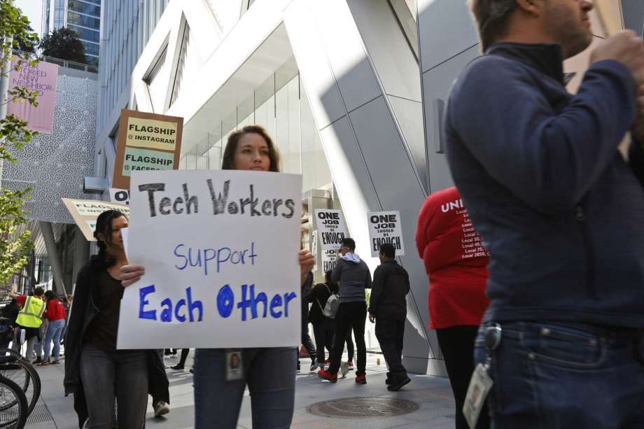 In this photo taken July 16, 2019, tech workers march to support Facebook's cafeteria workers, who were rallying for a new contract with their company Flaghship in San Francisco. Tech workers are speaking out on issues of immigration, the environment, sexual misconduct and military warfare like never before. Google, Amazon and Microsoft employees protest against how their work is used by the government. Through petitions and collective actions, others push for better internal policies, greener practices and better work conditions for contractors. Photo: Samantha Maldonado, AP / Copyright 2019 The Associated Press. All rights reserved.