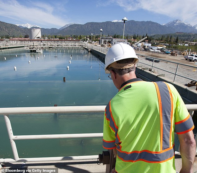 A California water treatment plant worker examines a reservoir.Known as 'forever chemicals,' PFAS are man-made and used in a wide variety of nonstick and waterproof products and firefighting foams