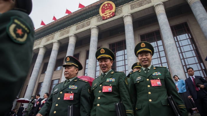 epa06272484 Chinese military delegates leave after the opening ceremony of the 19th National Congress of the Communist Party of China (CPC) at the Great Hall of the People (GHOP) in Beijing, China, 18 October 2017. China holds the 19th Congress of the Communist Party of China, the country's most important political event where the party's leadership is chosen and plans are made for the next five years. Xi Jinping is expected to remain as the General Secretary of the Communist Party of China for another five-year term.  EPA/ROMAN PILIPEY
