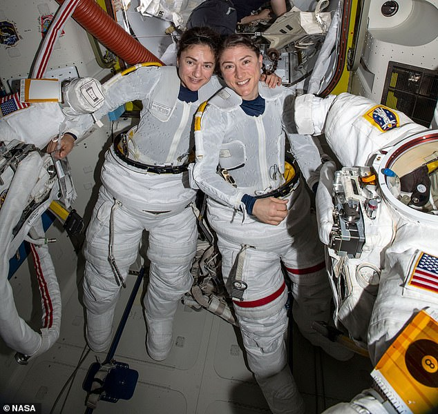 Astronauts Jessica Meir, left, and Christina Koch pose for a photo in the International Space Station after taking part in the first ever all-female spacewalk - mischaracterized by Trump as the first female spacewalk at all