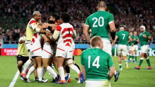 Japanese players celebrate their shock victory against Ireland