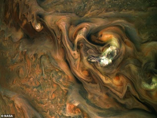 A new image of the swirling bodies of gas on Jupiter's surface, taken by NASA's Juno probe