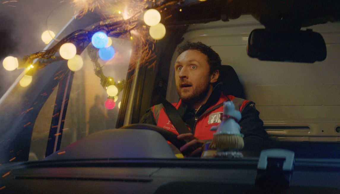 The festive ad features a Tesco delivery driver who travels back 100 years in time
