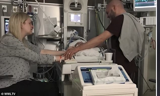 Over the next few days, Carson became a normal color, was able to breathe on his own and his bleed seemed healed. Pictured: Michelle and Brandon with their son shortly after he was born