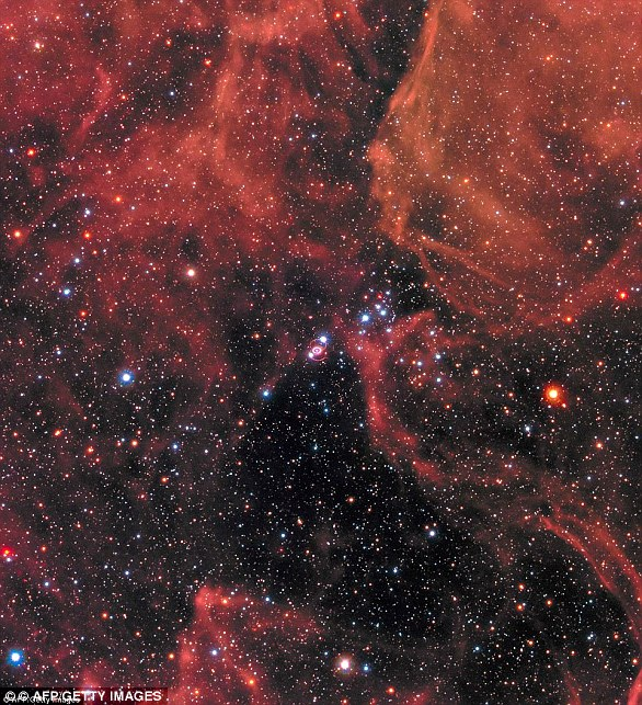 In 1987, astronomers spotted a 'titanic supernova' in a nearby galaxy blazing with the power of over 100 million suns (pictured)