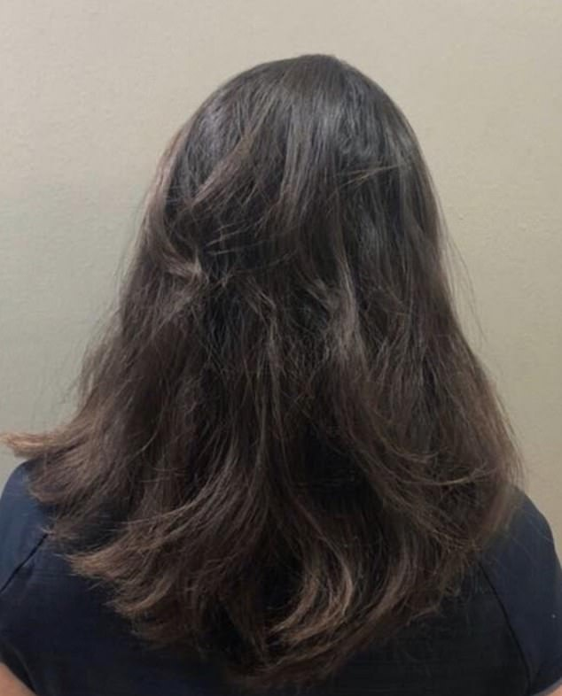 The girl is in a small minority of people who had her whole head of hair grow back after suffering with alopecia areata. Pictured, her hair after 19 months