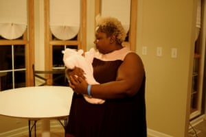 Jazmin Long, Vice President of Fund Development, nurses a baby at the Birthing Beautiful's headquarters.