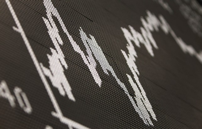 The graph of the DAX at the stock exchange in the central German city of Frankfurt am Main can be seen on April16, 2012. Eurex, a Frankfurt-based derivatives unit of stock market operator Deutsche Boerse, began trading Euro-OAT Futures, adding the instrument to a market which already exists for German and Italian debt. AFP PHOTO / DANIEL ROLAND (Photo credit should read DANIEL ROLAND/AFP/GettyImages)