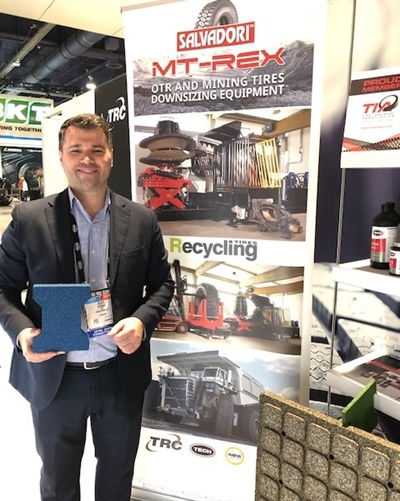Genti Bardhi displays a tile sample and an eco-friendly roof tile panel manufactured with Salvadori equipment by Ceyes, a company based in Europe. Tech International is bringing the tire recycling solutions of its sister company, Salvadori, to the North American market.
