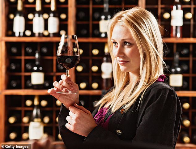 New research suggests many wine connoisseurs cannot actually tell one bottle from another (file photo)
