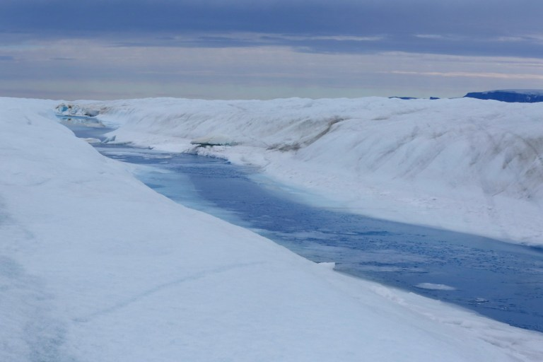 PETERMANN GLACIER, GREENLAND - AUGUST 27, 2016 A 30-mile-long meltwater river runs through Petermann glacier on August 27, 2016. Peterson's ice shelf broke off a piece roughly four times as large as Manhattan in 2010, and then another the size of two Manhattans in 2012. The shelf had by then lost 23 miles of its prior length, reaching a record low size. Petermann is one of Greenlands most enormous glaciers, lodged in a fjord that, from the height of its mountain walls down to the lowest point of the seafloor, is deeper than the Grand Canyon. And this ice shelf is its frontal extension, spreading out over the half mile or more deep waters of the fjord and actually afloat. The shelf is shrinking, and not quietly when ice shelves go, they can lose huge city-sized chunks at a time.The data stations the scientists installed there the year before are studying how quickly the glacier's ice shelf is melting. They installed a cable from the surface of the glacier down to the bottom of the ocean at the station. The cable has five ocean sensors attached to it that measure things like temperature and salinity, which indicate melt rates. But the station stopped transmitting data about six months ago, and the scientists did not know why until they reached it today. The data was still there, capturing regularly every few hours. The problem was that the Iridium stopped working even though data was still recording. The scientists will work through the night to try to repair the station and restart transmission. From Greenland to Antarctica, disappearing ice shelves have been one of the leading indicators of climate change and Greenland, melting faster than its larger southern rival, now has just a few shelves like Petermann left. The scientists worked on Petermann for about 30 hours, skipping sleep to work through the night, before taking off again. Photo by Whitney Shefte / The Washington Post via Getty Images