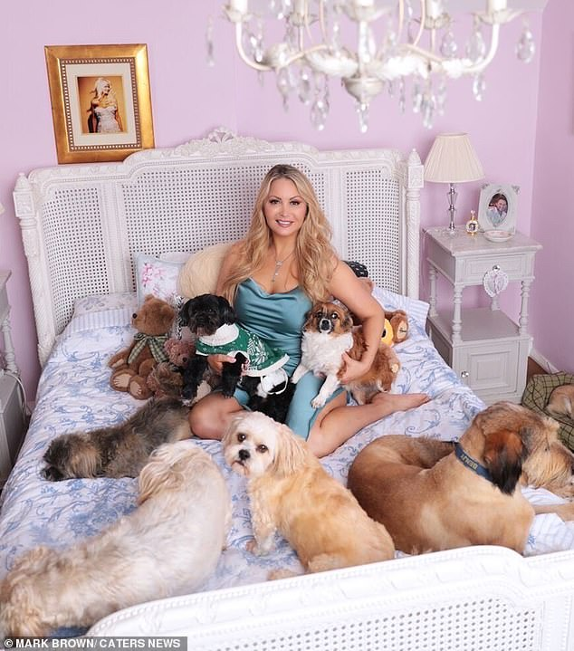 Fabulous dog lady. Victoria adopted a completely plant-based and teetotal lifestyle aged 33 (pictured now with her dogs)