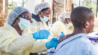 A healthcare member inoculates a man for Ebola in Butembo, Democratic Republic of the Congo on July 27, 2019.