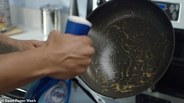 More than 60 per cent of Americans now 'clean-as-they-go' when it comes to clearing away pots, pans and plates after cooking. P&G created a new spray - pictured - that it claims makes that job easier