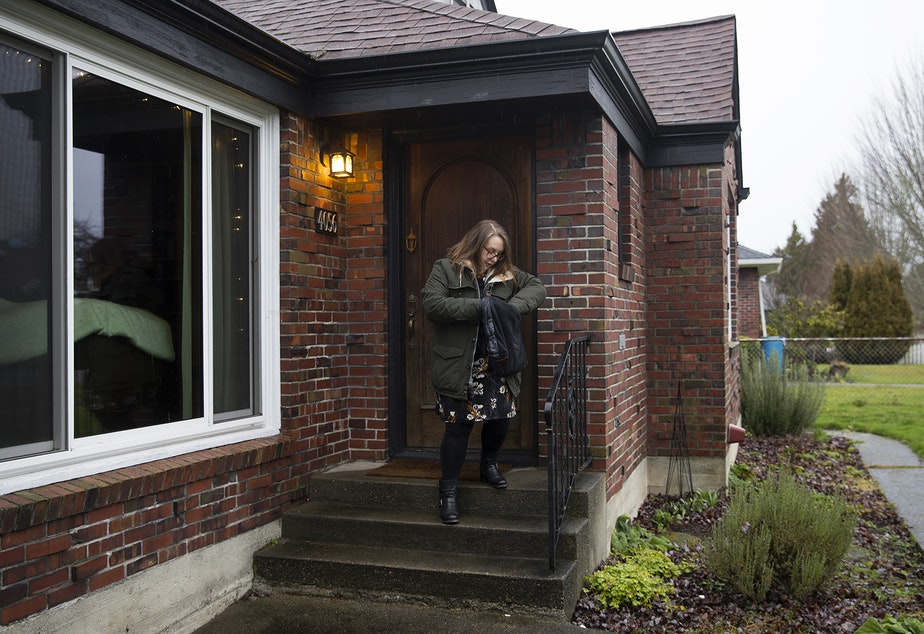 Kara Peters leaves her home to walk to her bus stop on Wednesday, January 22, 2020, before commuting from Tacoma to Seattle for work.