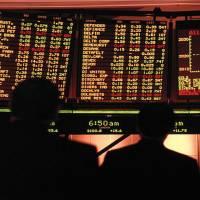 Asian stocks under pressure after spike in coronavirus cases