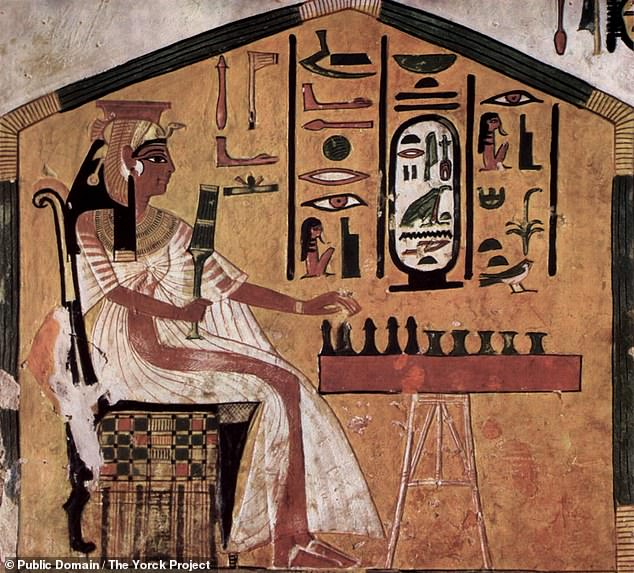 The game — senet — was played across all levels of Egyptian society from its emergence 5,000 years ago until it fell out of popularity some 2,500 years later. Pictured, Queen Nefertari — wife of Ramses II — is depicted playing Senet in a piece of art in her tomb