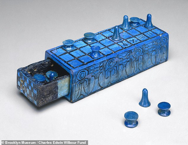 Experts think that senet progressed from being essentially an ancient version of ludo to something closer to an Ouija board — a conduit through which the living might commune with the dead. Pictured, an elaborate Senet game set with sliding drawer, inscribed for the pharaoh Amenhotep III, believed to date back to around1390–1353 BC