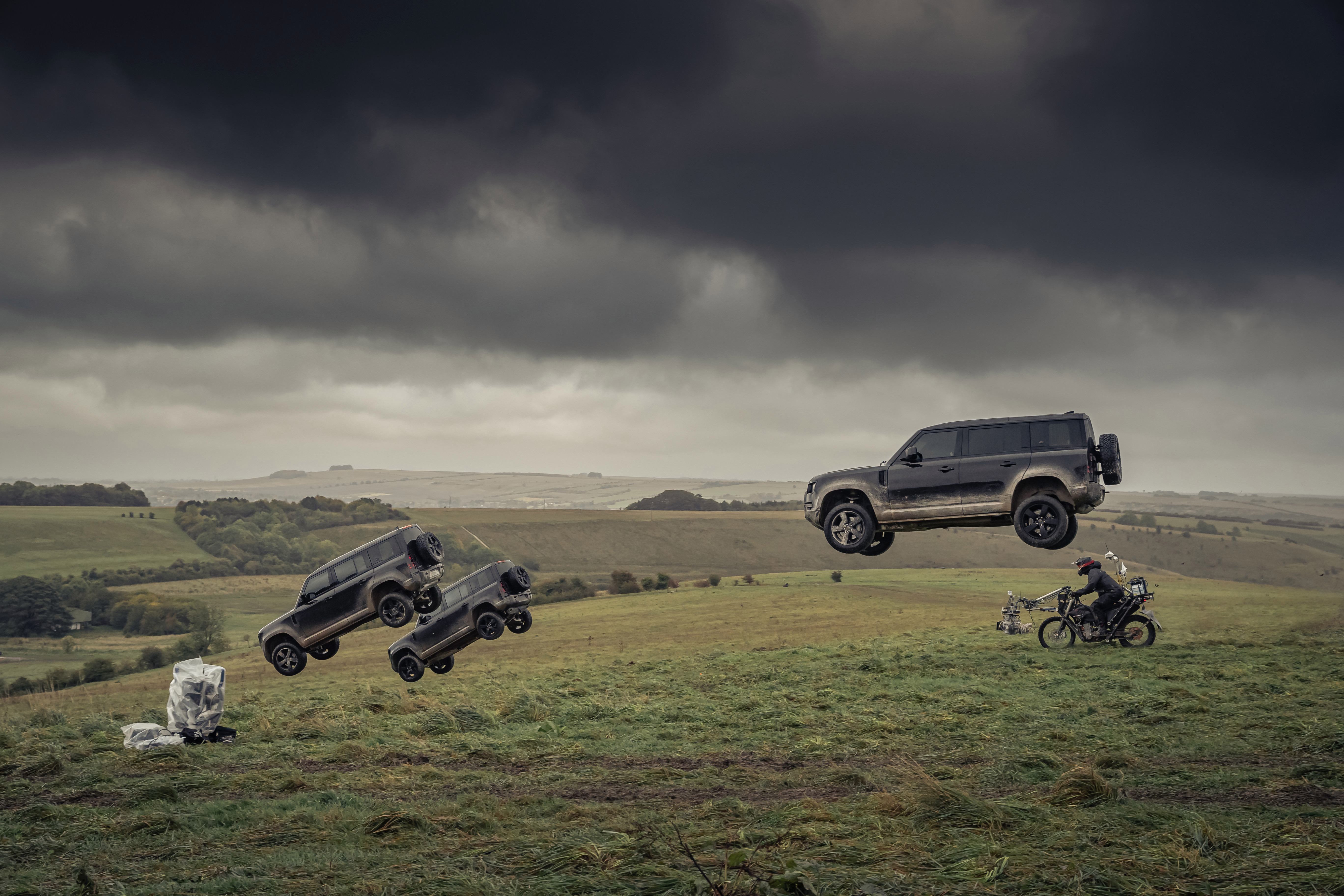 The Land Rover Defender hurtles through the air in the behind-the-scenes look at No Time To Die