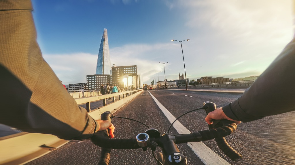 cyclist's point of view riding over a bridge in London