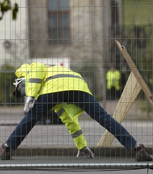 Pictured: A worker a the site for coronavirus testing