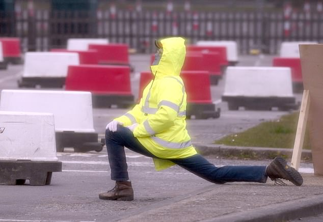 Workers were seen sitting, standing around and stretching at the testing centre in Chessington, south-west London today