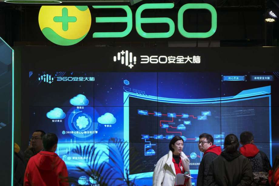 """In this photo released by Xinhua News Agency, visitors tour the Chinese internet security firm Qihoo 360 showcasing it 5G digital security and protection system at the World 5G Convention in Beijing on Nov. 21, 2019. One of China's biggest tech companies has criticized the Trump administration for """"politicizing business"""" after it slapped export sanctions on 33 more Chinese enterprises and government entities. (Li Xin/Xinhua via AP) Photo: Li Xin, AP / Xinhua"""