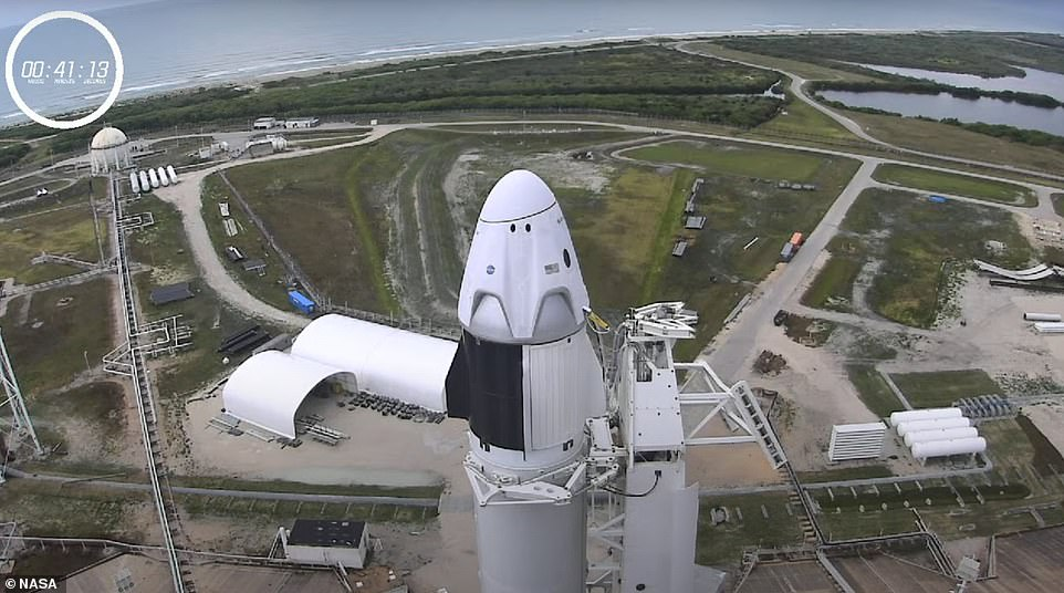 NASA astronauts Robert Behnken and Douglas Hurley were strapped in the cabin of Crew Dragon Capsule, the access arm had retracted, fuel was loaded and the launch escape system is armed in case of a disaster. Everything is 'go', but the weather, a SpaceX member said during the livestream as on-and-off rain threatens the liftoff of 'Launch American'