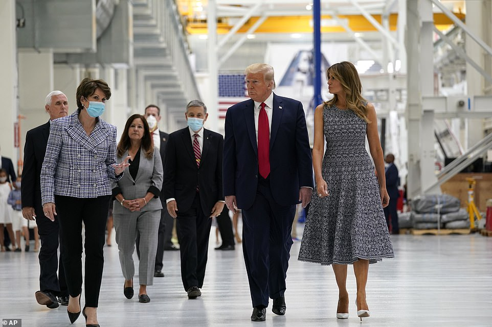 The Trumps had left the White House shortly after lunch, with the president skipping a Q&A with the gathered press, holding the first lady's hand as they boarded Marine One, neither wearing face masks