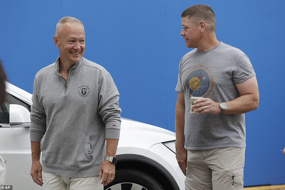 NASA astronauts Robert Behnken (right) and Douglas Hurley (left) arrived at Kennedy Space Center in Cape Canaveral, Florida, bringing them one-step closer to making history. The pair were chauffeured into the facility by a white Tesla Model X with NASA stickers placed on the front doors and decals on the windshield form each of the space fairing heroes