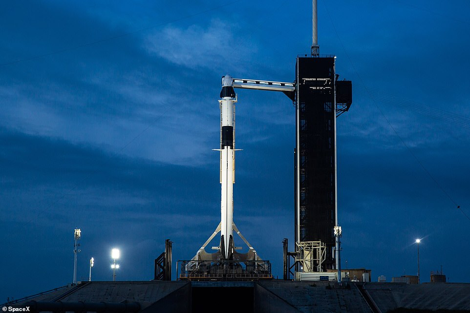 SpaceX's Falcon 9 stands tall on Launch Complex 39A. The rocket will launch from US soil carrying two NASA astronauts to the International Space Station - a mission that has not taken placed in nine years