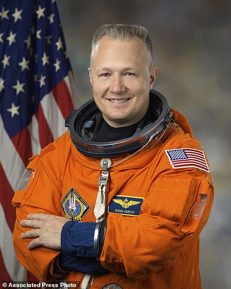 This Feb. 11, 2011 photo provided by NASA shows astronaut Douglas Hurley in a Launch Entry Suit used in space shuttle missions. (Bill Stafford/NASA via AP)