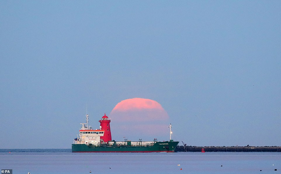Earlier this month the final supermoon of the year graced the skies. It is pictured above at Poolbeg Lighthouse in Dublin Bay