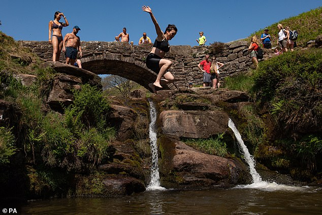 England is set to move into the next phase of the lockdown from tomorrow, with up to six people able to meet, despite scientists' fears it will cause a second wave of infections. Pictured: People at Three Shires Head on the River Dane, Derbyshire