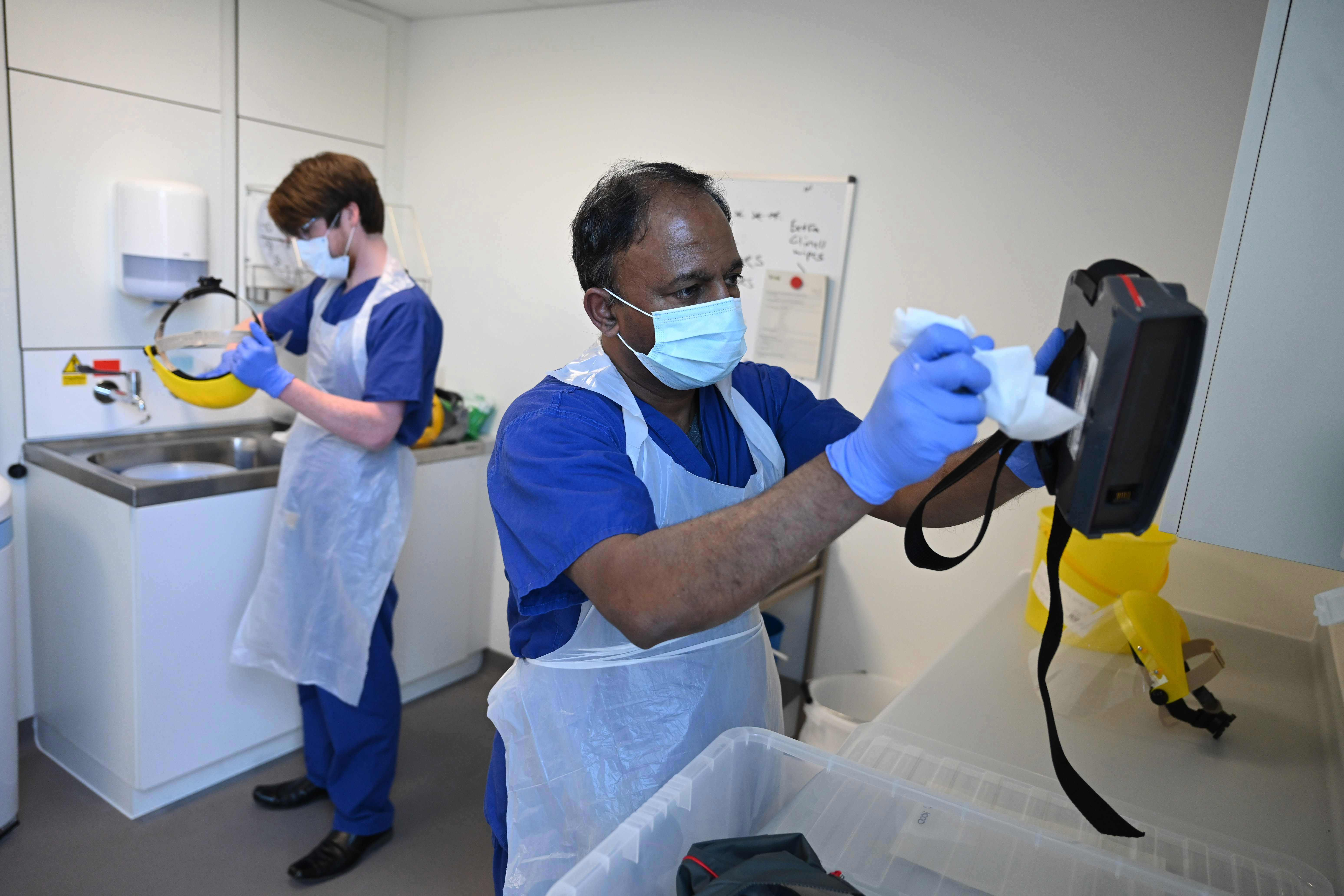Clinical staff clean and sanitise personal protective equipment at Royal Papworth Hospital in Cambridge