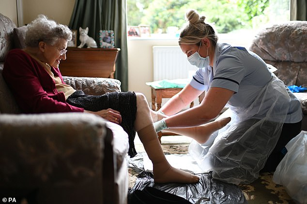 Coronavirus is harder to contain within care homes because many residents are not capable of looking after themselves so cannot self-isolate when they're ill (Pictured: A carer in protective equipment helps a resident)