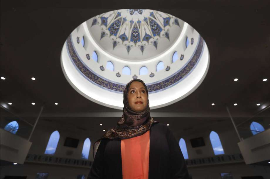 "In this Monday, June 22, 2020, photo, Hind Makki, poses for a portrait at the The Prayer Center of Orland Park in Orland Park, Ill. Makki remembers how, as a young girl, she would call out others at the Islamic school she attended when she heard an Arabic word that means ""slave"" casually used to refer to Black people. ""Maybe 85% of the time, the response I would get from people...is 'Oh, we don't mean you, we mean the Americans,'"" Makki said during a virtual panel discussion on race. Photo: Charles Rex Arbogast, AP / Copyright 2020 The Associated Press. All rights reserved"