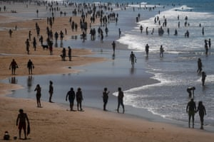 People enjoy the sun at Carcavelos beach in Cascais in the outskirts of Lisbon last Tuesday.