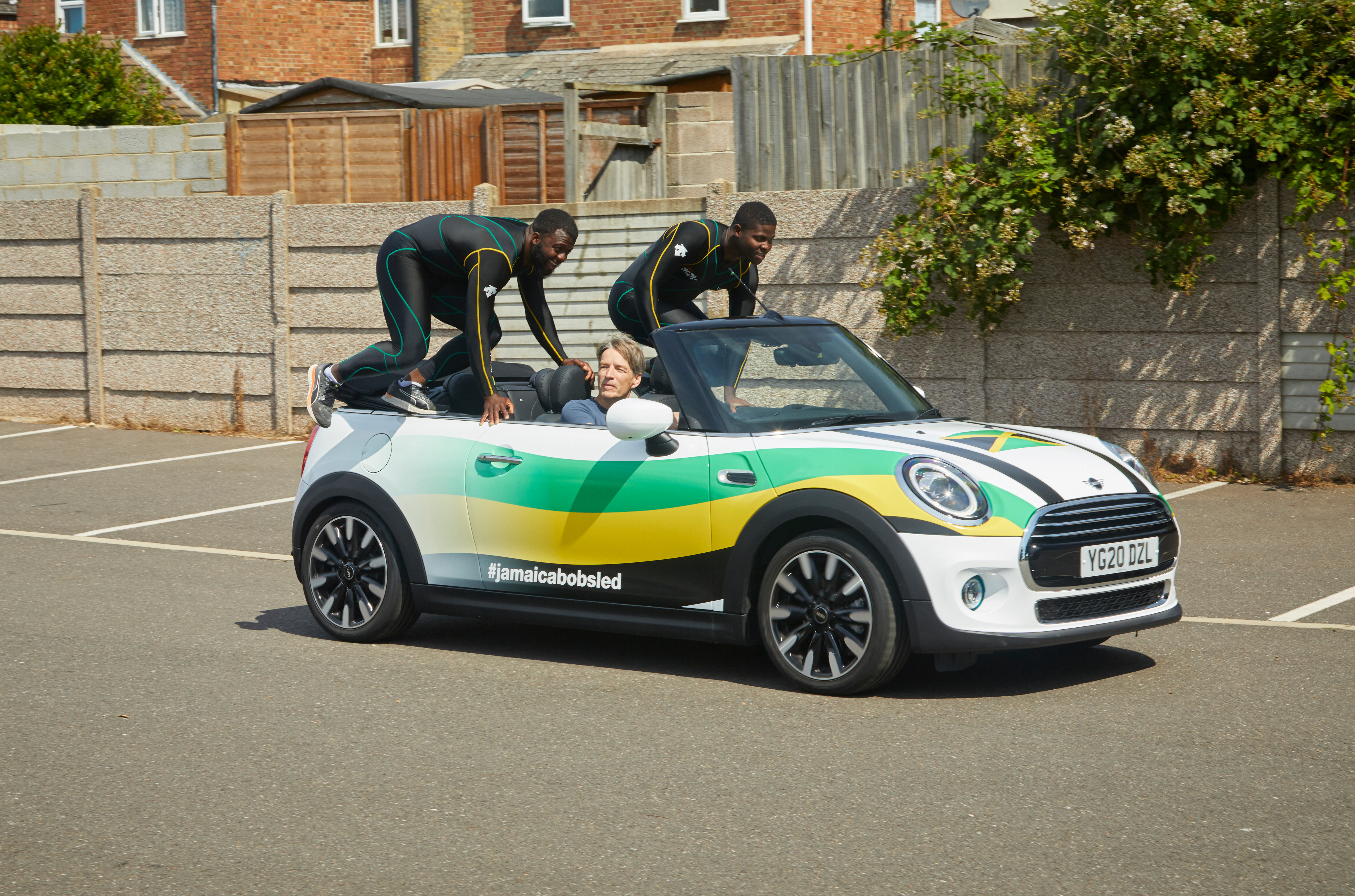Jamaica's bobsled duo push a Mini convertible during lockdown to train for Winter Olympics