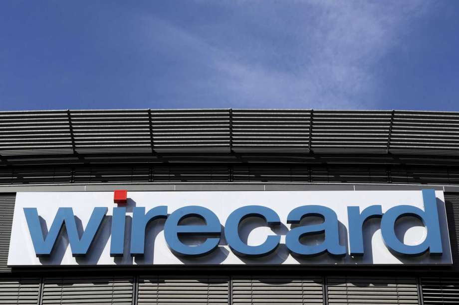 FILE - In this  Thursday, April 25, 2019 file photo the logo of financial services company wirecard is pictured at the headquarters in Munich, Germany. Shares in German payment service provider Wirecard AG plunged Thursday as the company announced it was postponing its delayed annual report yet again. Photo: Matthias Schrader, AP / Copyright 2019 The Associated Press. All rights reserved.