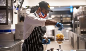 A chef in the kitchen of the Hard Rock Cafe in Piccadilly Circus, London