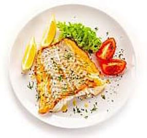 Baked cod with lemon and herbs is pictured above