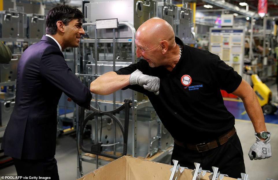 Chancellor Rishi Sunak greets a worker with a coronavirus-friendly elbow-bump at the Worcester Bosch boiler factory in Worcester yesterday