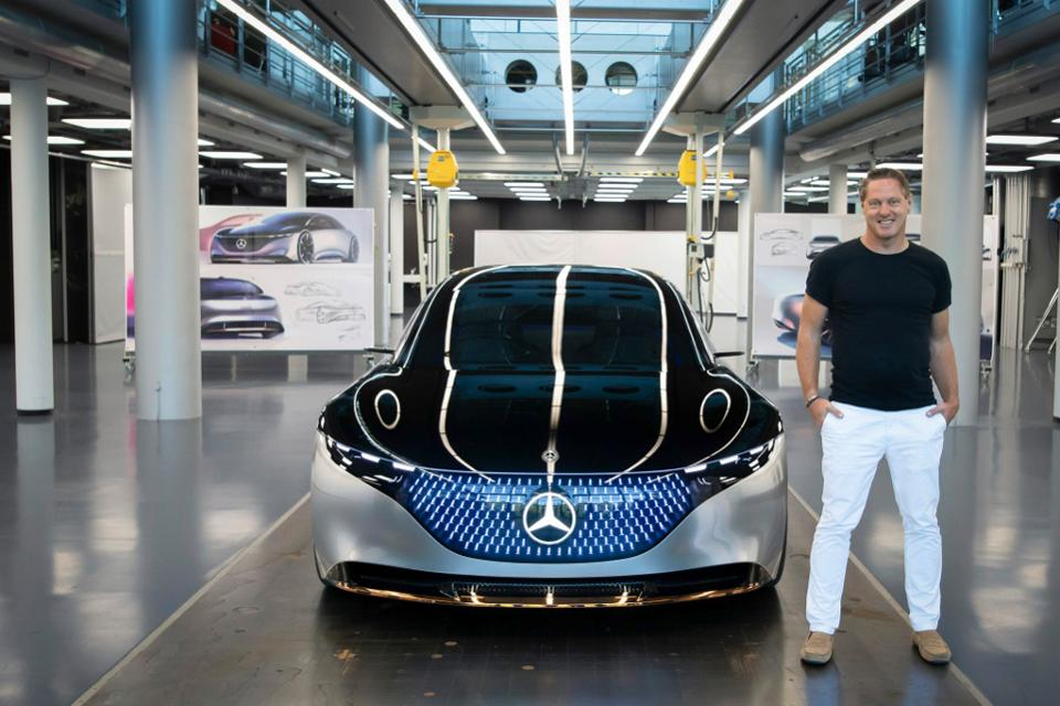 Gorden Wagener stands next to his 2019 Mercedes Vision EQS