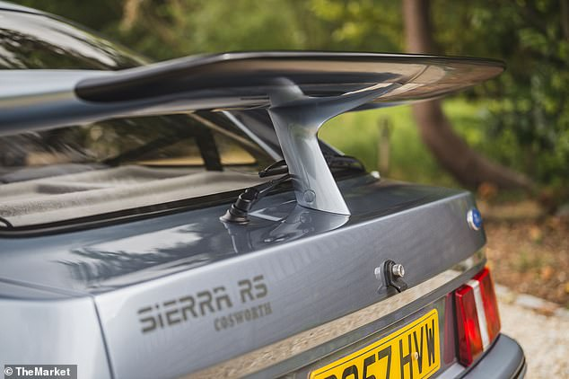 Flared wheel arches, a vented bonnet and this unmistakable 'whale tail' rear wing had teenage boys drooling over the modified family car