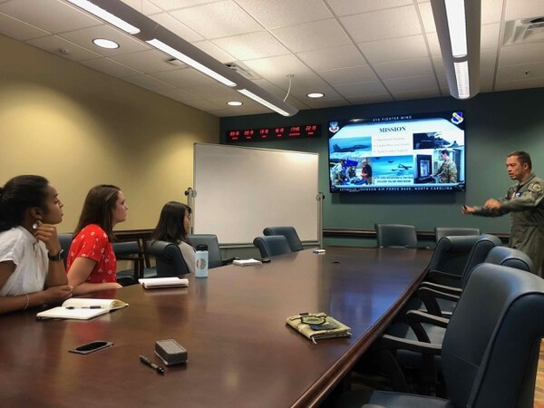 Col. Donn Yates, right, discusses new concepts for fighting in a SATCOM-denied environment with Hacking for Defense students Mary Gooneratne, Joy Duer and Linda Zhang at Seymour Johnson Air Force Base on Sept. 18, 2019. (Tommy Sowers)