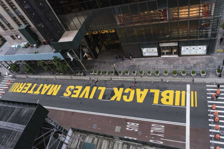 Pedestrians walk on a Black Lives Matter mural painted in front of Trump Tower, Friday, July 10, 2020, in New York. Photo: Yuki Iwamura, AP / FR171758 AP