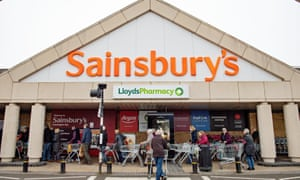 People queuing outside a Sainsbury's supermarket
