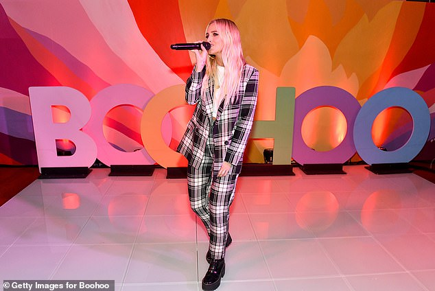 Ashlee Simpson performs at a Boohoo event in New York City last year. Shares in the fashion giant plunged 14% yesterday as it struggled to draw a line under the sweatshop slavery scandal